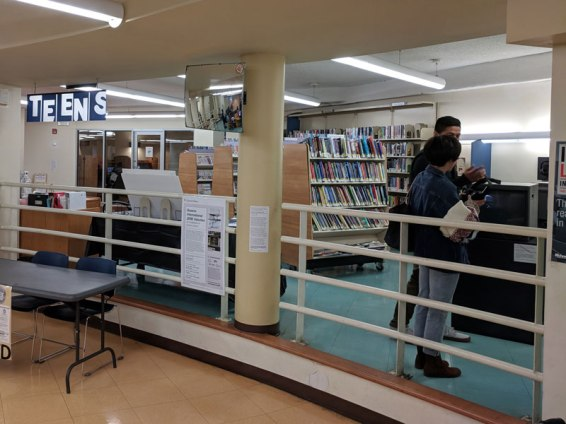"""Fel Santos' installation is in the teen area (right). Our writing station can be found next to the entrance to the """"silent room"""" (left, in background)."""